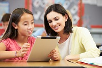 Young gril with Teacher and iPad
