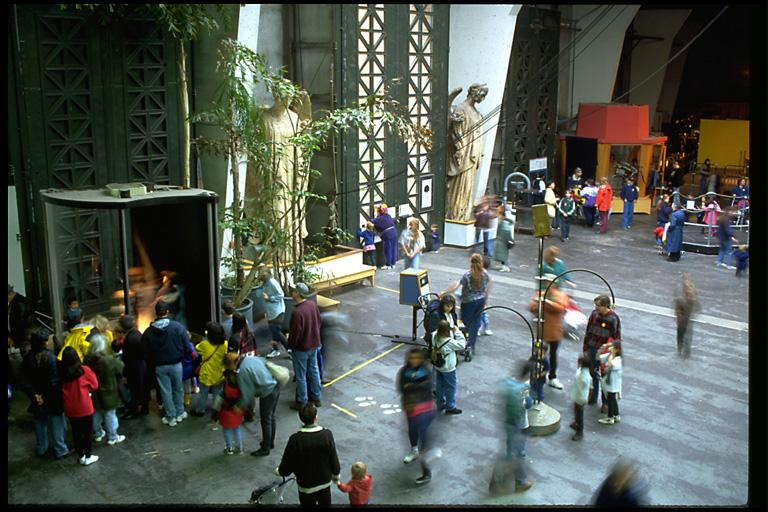 children in a large open hall at the Exploratorium