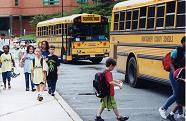image of young children boarding a school bus